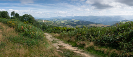 Photo for Panoramic landscape along the Camino de Santiago trail between Grandas de Salime and Fonsagrada, Asturias, Spain - Royalty Free Image