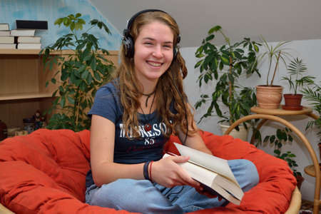 Teenager listens comfortably in room music