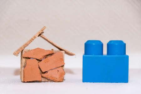 Photo pour Model of a dream house shows with a child's play block size comparison - croped image - image libre de droit