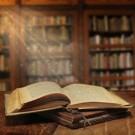 Photo pour  Opened magic book with magic light - image libre de droit