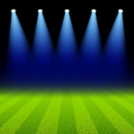 Bright spotlights illuminated green soccer field