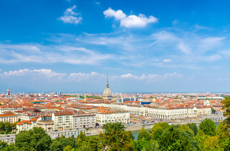 Foto per Aerial top panoramic view of Turin city center skyline with Piazza Vittorio Veneto square, Po river and Mole Antonelliana building with high spire, blue sky white clouds background, Piedmont, Italy - Immagine Royalty Free
