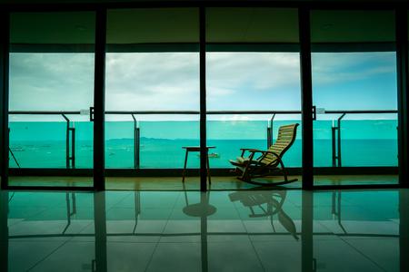 Foto de Daybed beach chair n  balcony, hotel room, Pattaya, Thailand - Imagen libre de derechos