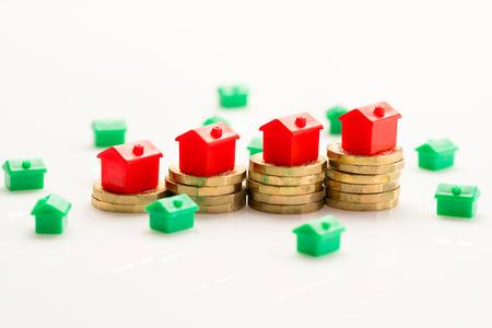 Photo pour Housing estate concept with coins in studio - image libre de droit