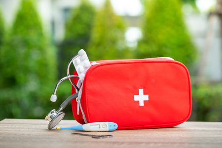 Foto de First aid kit bag in outdoor - Imagen libre de derechos