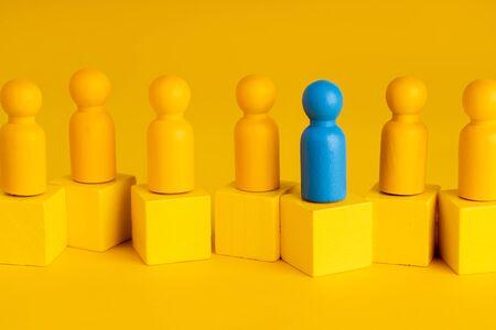 Photo pour Business & HR global wood puzzle concept for leadership and team with peg doll - image libre de droit