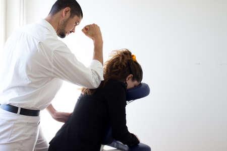 business woman receiving shiatsu on a quick massage chair
