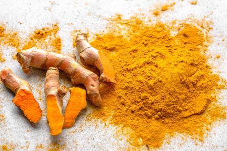 Foto für Fresh root and turmeric powder, indian spice, healthy seasoning ingredient for vegan cuisine - Lizenzfreies Bild
