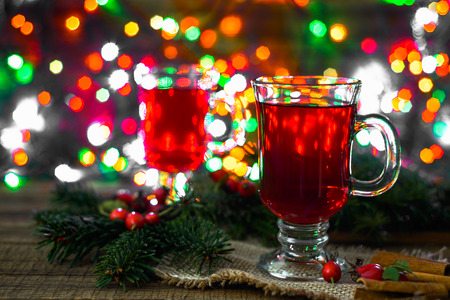 Photo pour Hot mulled wine on table, magic atmosphere under Christmas tree with lights - image libre de droit