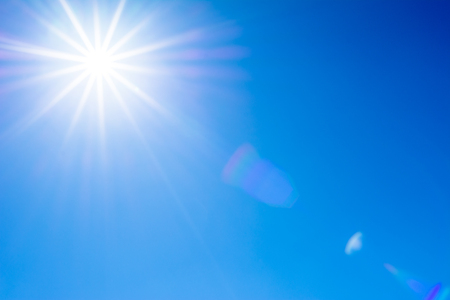 Photo for Blue sky and sun with flare - Royalty Free Image