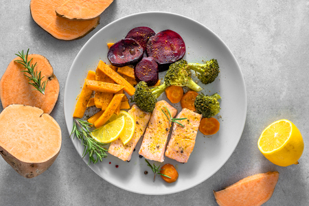Photo for Dietary dish with grilled salmon and vegetables baked in oven - Royalty Free Image