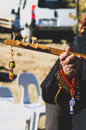 Hand of an old peasant and playing an instrument in Turkey