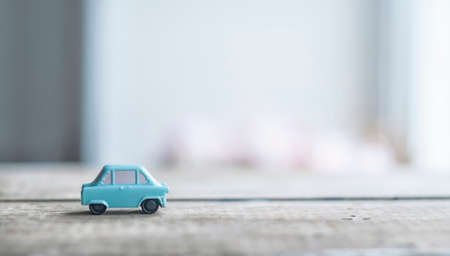 Photo for Toy model of retro car in nursery room - Royalty Free Image
