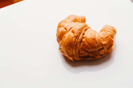 fresh croissant from the puff pastry on a white background.