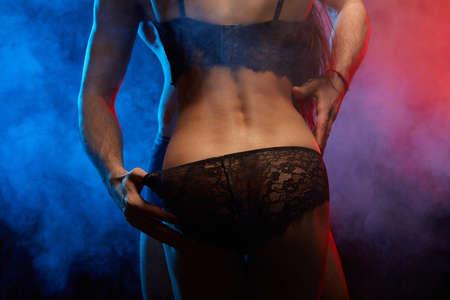 Photo pour man holding his lovers underpants during sex. close up cropped photo - image libre de droit