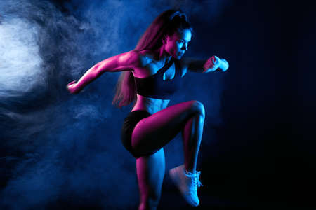 Photo for awesome sportswoman warming up before training, runner preparing for a compatition. leisure, pastime. close up side view photo - Royalty Free Image