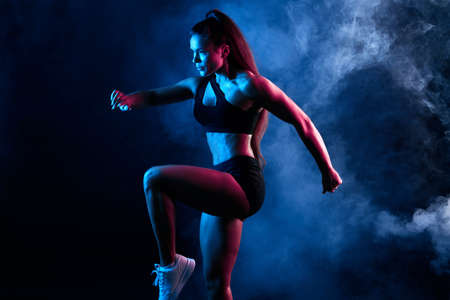 Photo for talented woman dancing in the night club, performance, entertainment. close up side view photo. isolated black background, studio shot - Royalty Free Image