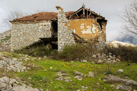 An abandoned house in the mountains. The migration of the people and the abandonment of their homes