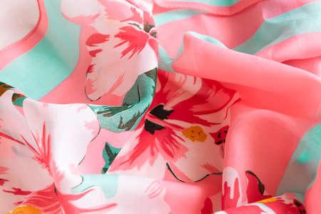 Photo pour Fresh colorful folded cloth. Crop view of fashioned botanical fabric, pink and blue pastel colors - image libre de droit