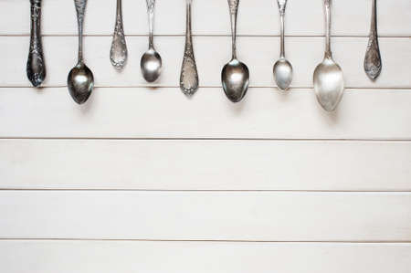 Silver spoons on the white table