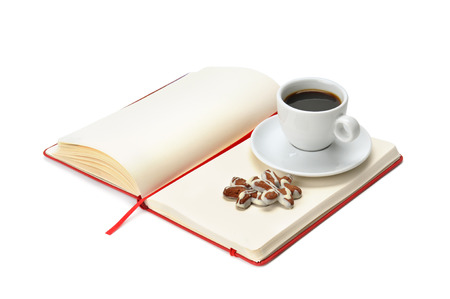 notebook and cup of coffee isolated on white background