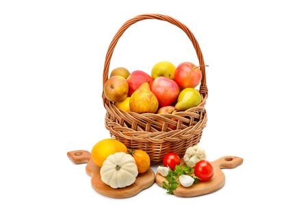 Vegetables and fruits in a basket isolated on white background. Healthy food.の写真素材