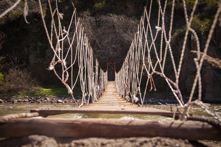 Rope woden bridge in the kazakhstan mountains