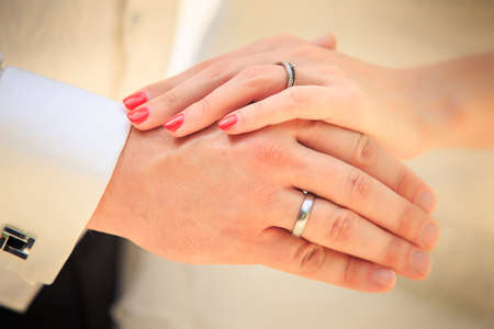 Photo for bride and groom hands with golden rings clouseup - Royalty Free Image