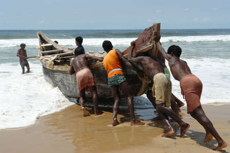 Indian fishermen pushing the boat