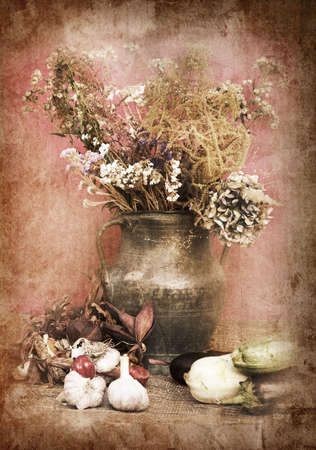 still life of a flowers in a vase with vegetables