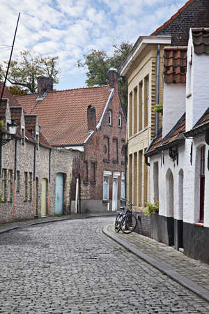 Cityscape of Bruges streets with bicycle, Belgium.