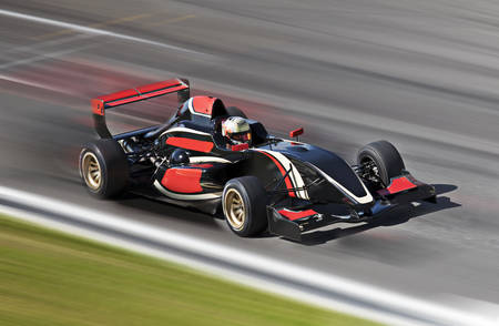 Photo pour Formula one race car on speed track with motion blur - image libre de droit