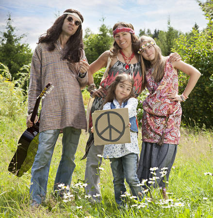 Portrait of hippie family standing in the field with Pacific sign