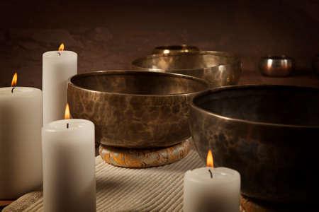 Foto für Tibetan singing bowls with burning candles close-up - Lizenzfreies Bild