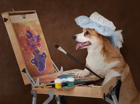Foto de Welsh corgi Pembroke dog artist painting still life with a bouquet of flowers - Imagen libre de derechos