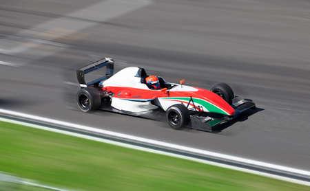 Photo pour Motion blur of racing car on speed track - image libre de droit