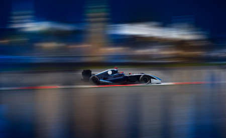 Photo pour Motion blur of racing car on speed track - image libre de droit