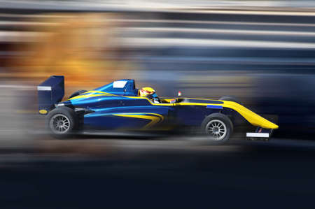 Foto de Formula 4.0 race car racing at high speed on speed track with motion blur - Imagen libre de derechos