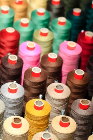 Photo pour Background of the reels with colorful threads  - image libre de droit