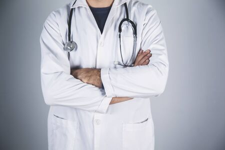 Photo pour doctor hand stethoscope on the gray wall background - image libre de droit