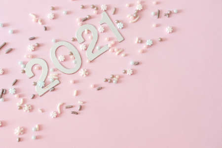 Photo for Silver Christmas decorations and sugar sprinkles on pastel pink background. Flat lay style. Holiday classic concept. - Royalty Free Image