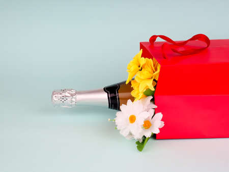 flowers in the package on blue background, space for text.