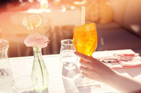 Photo pour Colorful iced cocktail on dinner table - image libre de droit