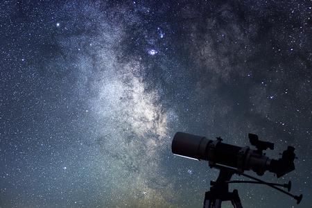 Telescope in starry night. Milky way and telescope. Astronomy