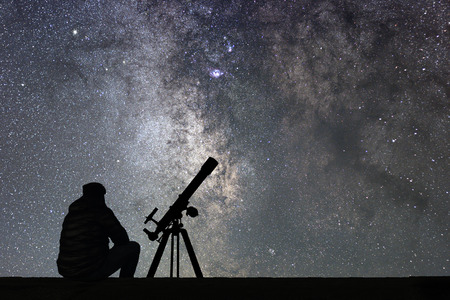 Photo for Man with astronomy  telescope looking at the stars. Man telescope and starry sky. Night sky. Milky way galaxy. - Royalty Free Image