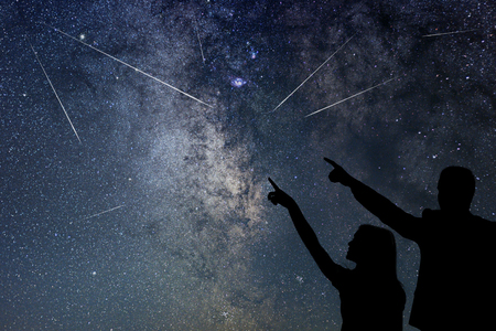 Photo pour Happy family are watching Meteor Shower. Nigh Sky. - image libre de droit