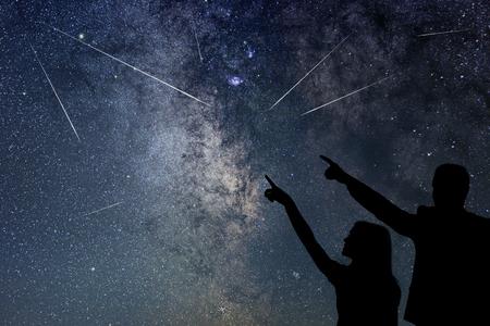 Foto de Happy family are watching Meteor Shower. Nigh Sky. - Imagen libre de derechos