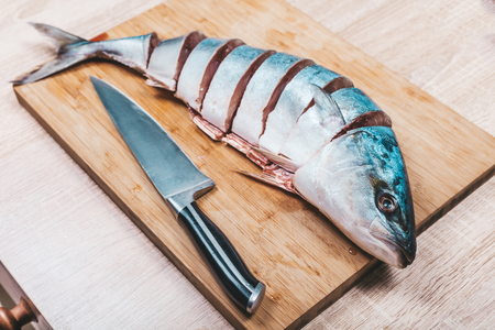 Photo pour raw tuna fish sliced on wooden background - image libre de droit