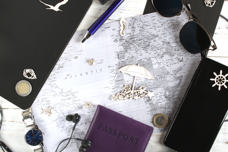 Tourism consisting of a map, phone, headset, passport and other elements of the upcoming vacation
