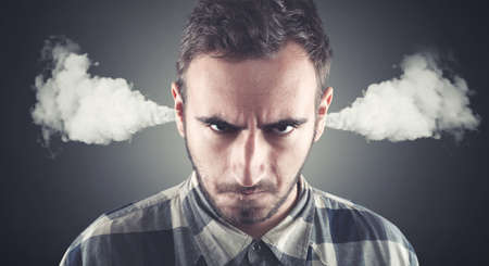 Photo for Angry young man, blowing steam coming out of ears, about to have nervous atomic breakdown. Negative human emotions, facial expressions, feelings, attitude - Royalty Free Image